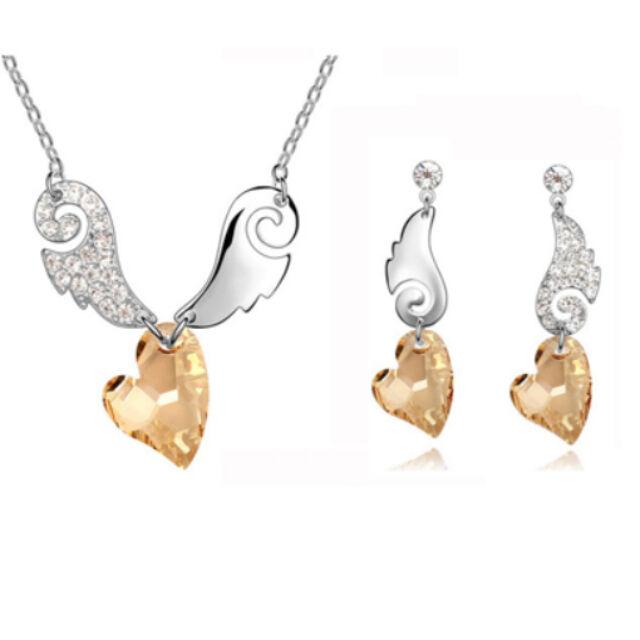 Szárnyas nyaklánc+fülbevaló szett pezsgő Swarovski szívvel